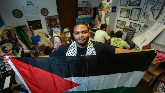 Robert Gardner, a senior at UCLA, stands in the Students for Justice in Palestine office. (Ringo H.W. Chiu / For The Times)